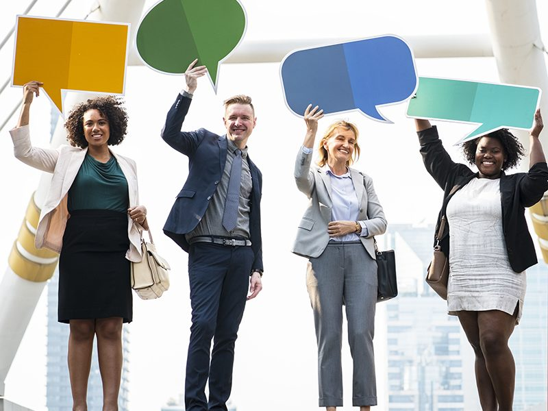 Successful business people with speech bubbles